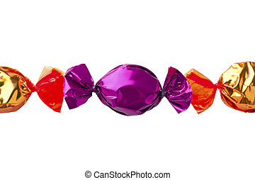 purple candy arranged in between of golden candies - Cropped...