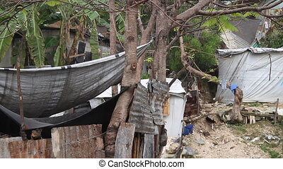heavy rain in shanty town neighborhood Port-au-Prince Haiti