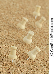push pins - Image of push pins on cork board