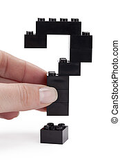 question mark made of black lego blocks - Close up image of...
