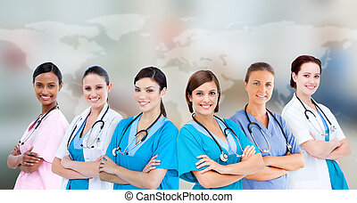 Medical workers standing against world map background