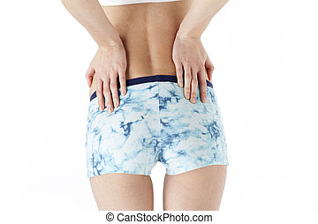 rear view image of a fitness model posing with hand on hips...