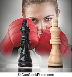 Female boxer behind the chess board - Female boxer with...
