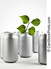 recycle cans - A group of cans with a branch to show...