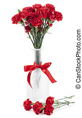 red carnation on a flower vase - Vertical image of a fresh...