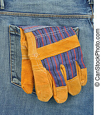 Back pocket of jeans with protective gloves