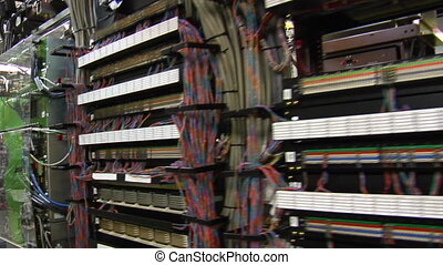 sweeping past racks of computer servers and equipment