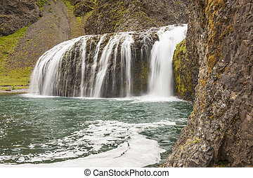 Mountain view - small cascade, Iceland. - View on cascade -...