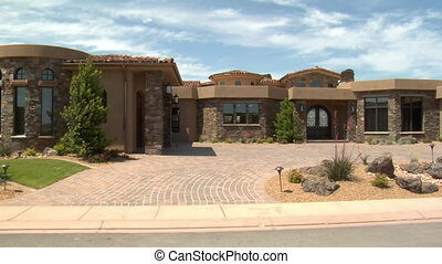 large desert home with circular driveway