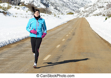 Sport woman running on winter - Athlete woman running on...