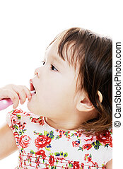Girl cleaning teeth - young girl cleaning her teeth with...