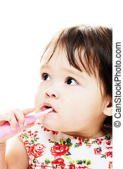 brushing teeth - Little girl brushing her teeth with pink...