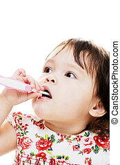 Girl Brushes Teeth - Young girl cleaning her teeth with pink...
