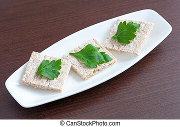Diet bread with parsley on a plate
