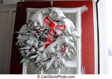 snowy wreath - winter storm - A Christmas wreath covered in...