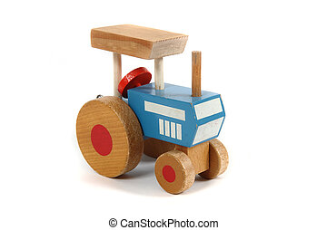 old wooden tractor toy isolated on the white background