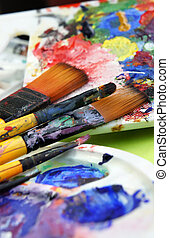 Art palette and paintbrushes