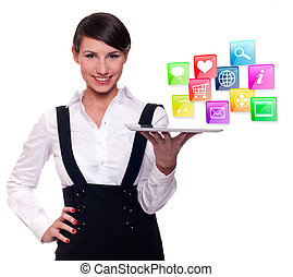 Young businesswoman with tablet computer and mobile and...