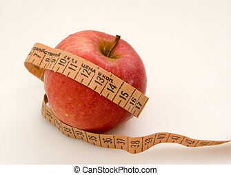 Red apple with measuring tape - Red juicy apple with...