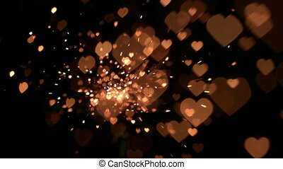 Gold confetti and sparks in slow motion