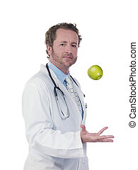 side view portrait of a doctor tossing green apple - Side...