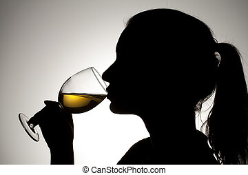 silhouette of a girl drinking wine