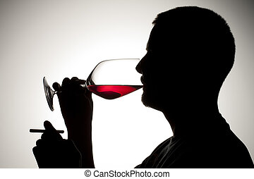 silhouette of a man with cigarette and wine - Silhouette...