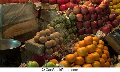 fruits in night time asia market and incence smoke