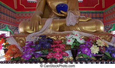 colorful ornate Buddha statue in Dharamsala temple,Himachal...