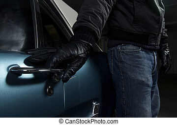 man trying to steal blue car