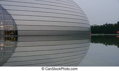 BeiJing China National Grand Theatre in reflection in lake water.ornate modern