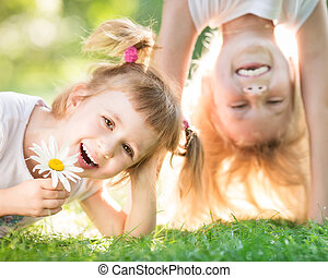 Active kids - Active happy children playing outdoors in...