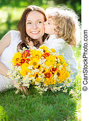 Mother`s day - Child with big bouquet of spring flowers...
