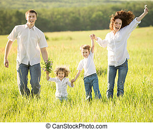 Active family outdoors - Active happy family jumping...