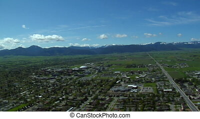 Aerial shot of Bozeman, Montana on blue-sky day