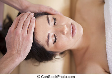 Being pampered at a spa - Gorgeous young woman being...