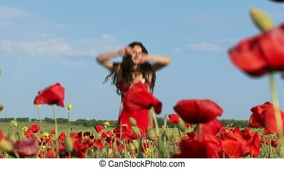 Posing in a poppy field - Woman posing in a blooming poppy...