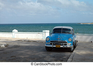 Blue Oldtimer - Blue oldtimer parking at the ocean