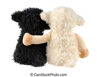 Two cute stuffed animals - Two plush lambs on white, one's...