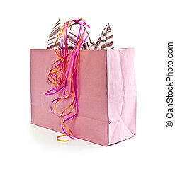 Pink shopping bag with ribbons isolated on white background