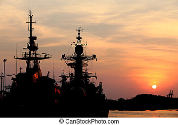 battleship with sunset behind
