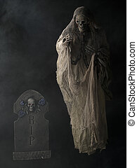 standing grim reaper and spooky tombstone - Illustration of...