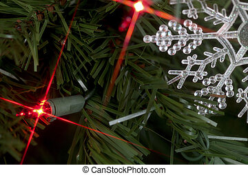 starry lights by snowflake in tree