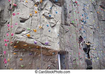 indoor rock climbing wall - an indoor rock climbing wall