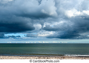 Storm clouds gathering over the ocean - View across a...