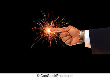 business man hand pointing on sparking fire
