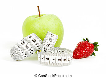 Measuring tape wrapped around a green apple and strawberry...