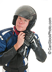 Portrait motor biker putting on his helmet - Portrait of a...