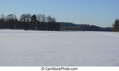 snowmobile lake frozen - man ride snowmobile transport on...