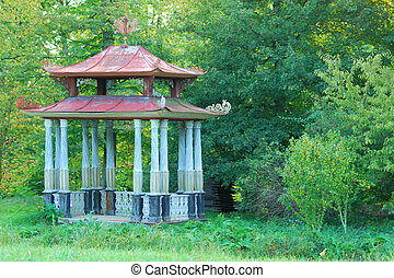 Small Chinese Arbour in a green forest park